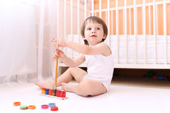 Lovely baby with paints at home Stock Photo