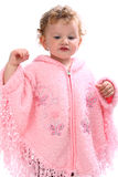 Lovely baby in pink poncho looking like an angel Stock Images