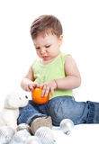 A lovely baby is playing Royalty Free Stock Image