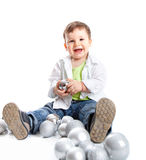 A lovely baby is playing with balls. Studio shot Royalty Free Stock Images