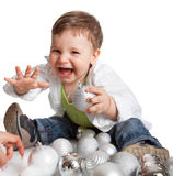 A lovely baby is playing with balls Royalty Free Stock Images