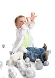 A lovely baby is playing with balls Stock Images