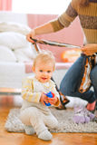 Lovely baby playing on floor Royalty Free Stock Photography