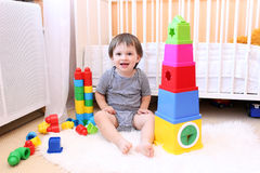 Lovely baby playing toys Stock Image