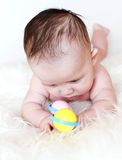 Lovely baby plays a rattle Royalty Free Stock Photos