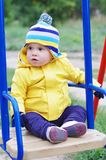 Lovely baby on seesaw. Lovely baby age of 11 months on seesaw Royalty Free Stock Image