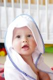 Lovely baby after shower wrapped in towel Royalty Free Stock Photography