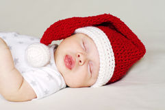 Lovely baby sleeping in a New Year's hat Royalty Free Stock Photos