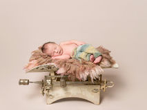 Lovely baby sleeping on old rusty scales Stock Photo