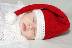 Lovely baby sleeping in santa hat Stock Photography