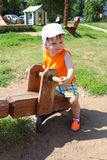 Lovely baby on teeter-totter in summer Royalty Free Stock Photos