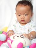 Lovely baby and toy monkey Royalty Free Stock Photo