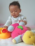 Lovely baby and toys Stock Image