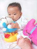 Lovely baby and toys Royalty Free Stock Photos