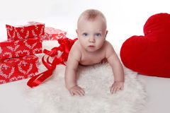 Lovely baby with Valentine's heart and gifts boxes Royalty Free Stock Photo