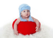 Lovely baby with Valentine's hearts Stock Image