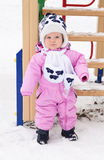 Lovely baby for a walk on a winter day Royalty Free Stock Image