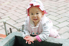Lovely baby washing hand. Stock Images