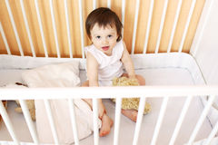 Lovely baby in white bed Royalty Free Stock Photo