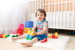 Lovely baby wiht toys at home Royalty Free Stock Images