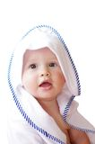 Lovely baby wrapped in towel on white background Royalty Free Stock Photo
