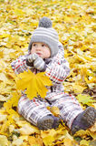 Lovely baby with yellow leaf Stock Photo
