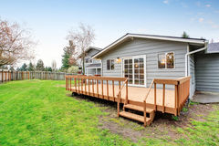 Lovely back yard with deck and grass. Stock Photos