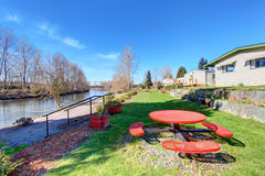 Lovely back yard with grass and river. Royalty Free Stock Images