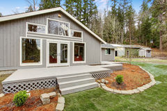 Lovely back yard with porch, and grass. Stock Photo
