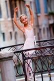 Lovely ballerina in Venice. Venice, Italy - Portrait of lovely ballerina on the bridge in Venice Royalty Free Stock Image