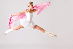 Lovely ballet dancer jumping exercising in studio Stock Photo