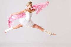 Lovely ballet dancer jumping exercising in studio Stock Photo