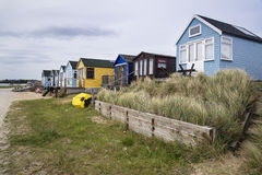 Lovely beach huts on sand dunes and beach landscape Royalty Free Stock Image