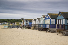 Lovely beach huts on sand dunes and beach landscape Stock Photos