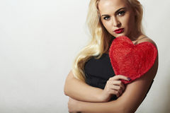 Lovely Beautiful Blond Woman with Red Heart. Beauty Girl. Show Love Symbol. Valentine's Day. Black Dress Royalty Free Stock Photos