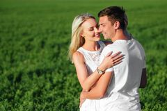 The lovely couple in love in a field. Royalty Free Stock Image