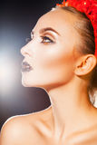 Lovely beautiful girl with healthy skin and makeup looking away Stock Photography