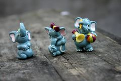 Lovely beautiful old baby toys elephant and hippo. Beautiful beautiful old children`s toys elephant and hippo collection macro royalty free stock photography