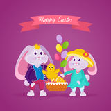 Lovely beautiful rabbits holding a basket with a Easter egg. Royalty Free Stock Images
