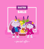 Lovely beautiful rabbits holding a basket with a Easter egg. Stock Photography