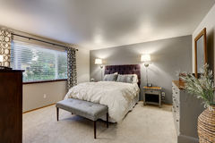 Free Lovely Bedroom With Grey Accent Wall Stock Photo - 86144180
