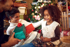 Lovely black child for Christmas with parents Royalty Free Stock Photo