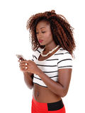 Lovely black woman texting. Stock Photography