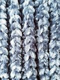 Knitted blanket. Gray pattern of knitted blanket background. Lovely blanket with gray pattern. Background with knitted texture stock images