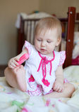 Lovely blond Baby girl playing with toy, selective focus Royalty Free Stock Photo