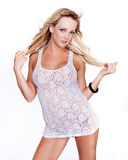 Lovely blond in Babydoll white lingerie Stock Photography