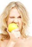 Lovely blond biting lemon Stock Photography