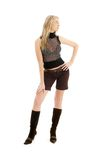 Lovely blond in brown shorts and boots Royalty Free Stock Image