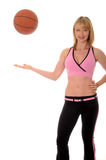 Lovely blond girl and basketball Royalty Free Stock Photo