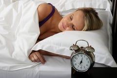 Lovely Blond Girl in Bed Stock Image
